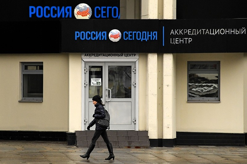 A woman walks past the headquarters of Russia's state-controlled Russia Today (RT) television company in Moscow on November 12, 2017. (AFP Photo)
