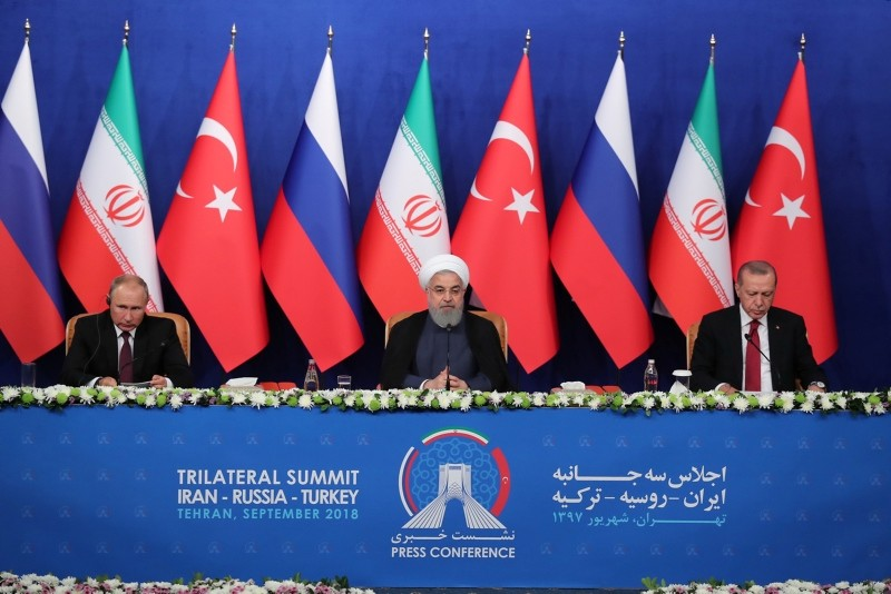 This handout photo shows Iranian President Hassan Rouhani (C), President Recep Tayyip Erdou011fan (R), and Russia President Vladimir Putin (L) during a joint press conference after their a meeting.