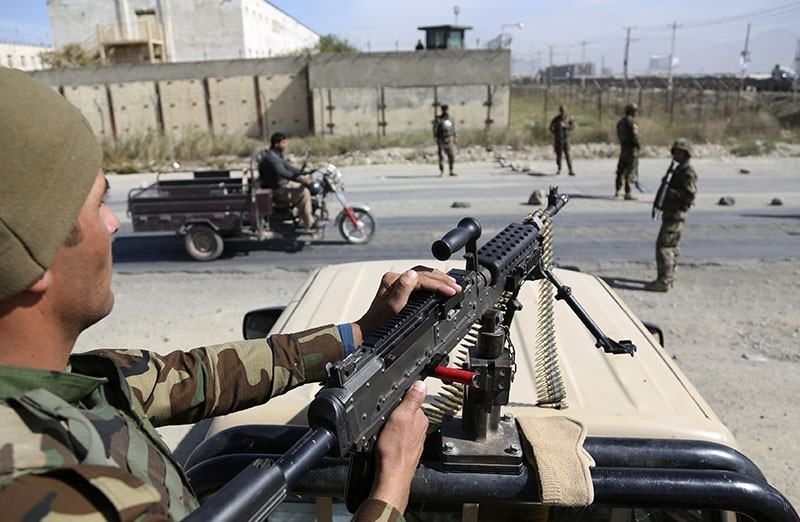 In this Wednesday, Oct. 17, 2018, photo, Afghan National Army soldiers stand guard at a checkpoint ahead of parliamentary elections, in Kabul, Afghanistan. (AP Photo)