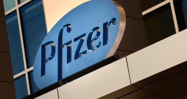 In this file photo taken on March 18, 2017, A sign for Pfizer pharmaceutical company is seen on a building in Cambridge, Massachusetts. (AFP Photo)