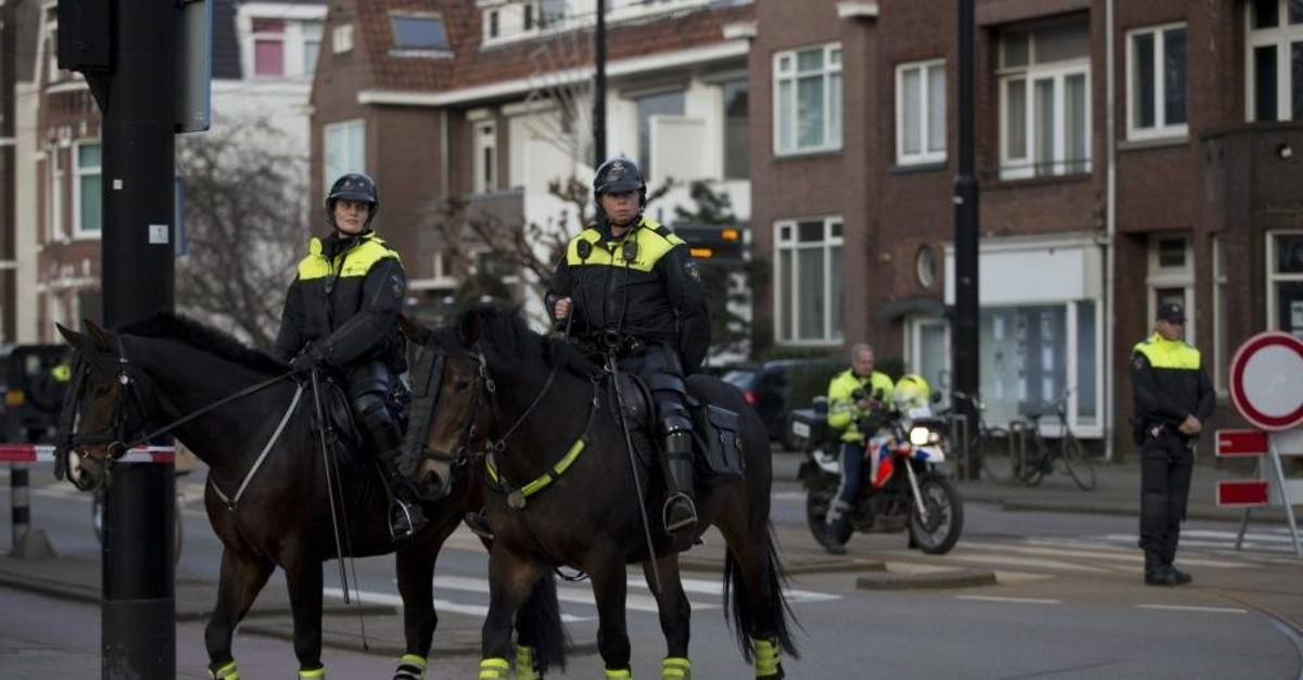 Dutch mounted police patrols as other police officers block the road (AP File Photo)