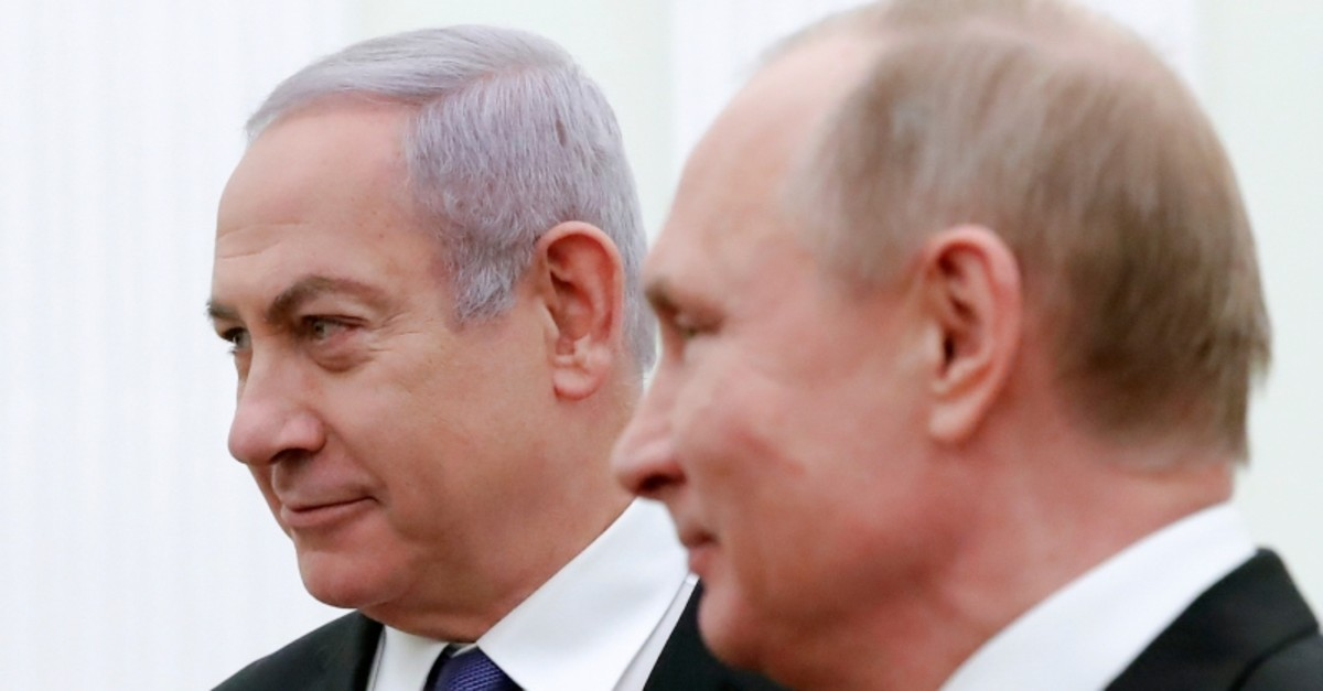 Russian President Vladimir Putin, right, and Israeli Prime Minister Benjamin Netanyahu pose for a photo during their meeting in the Kremlin in Moscow, Russia, Feb. 27, 2019. (AP Photo)