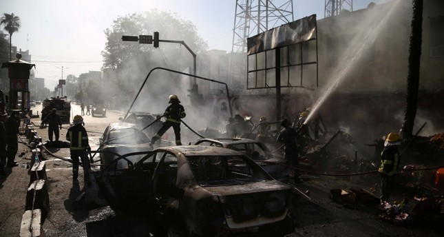 Afghan firefighters work at the scene of a suicide bomb attack, in Jalalabad, Afghanistan, 01 July 2018.