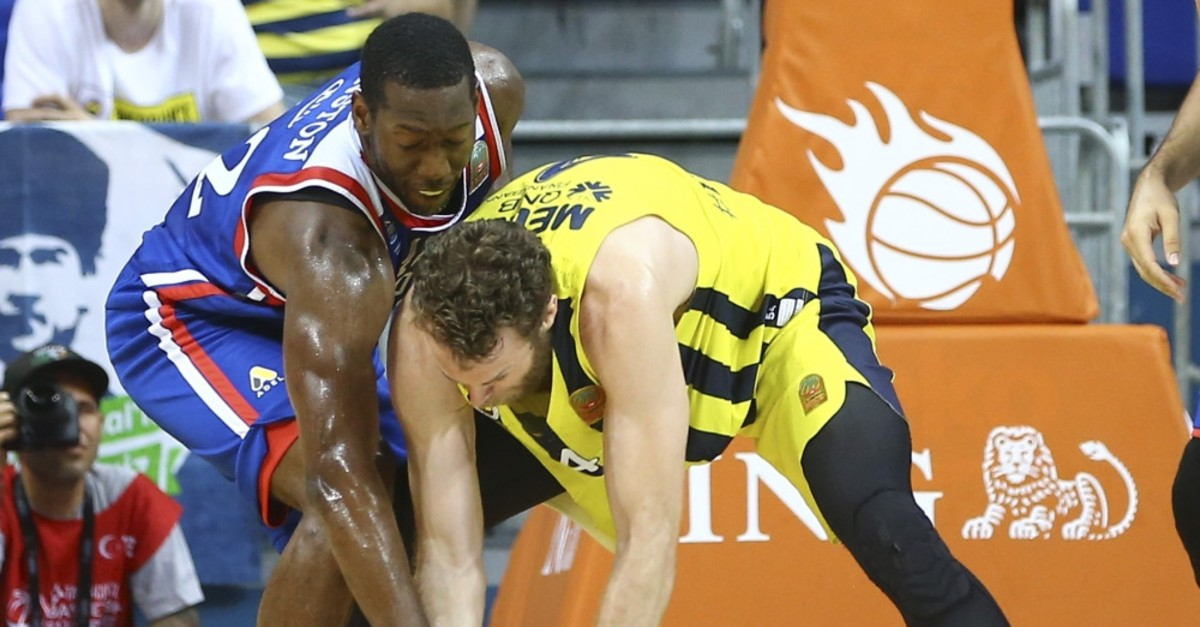 Host Fenerbahu00e7e Beko's Italian star Nicolo Melli (R), who scored 19 points, guarded by Anadolu Efes's Bryant Dunston, June 15, 2019.