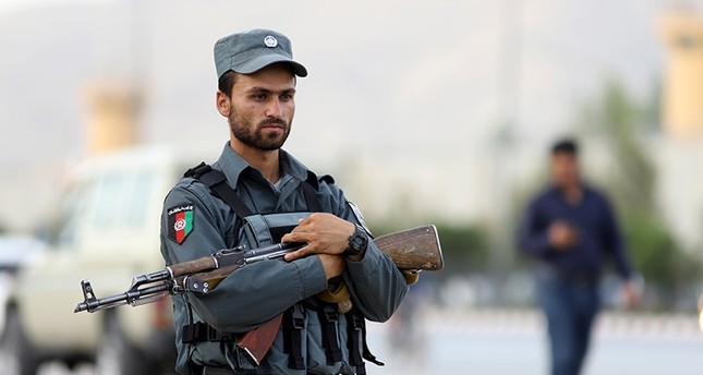 An Afghan security officer secures the scene of a suicide attack near the Ministry of Rural Rehabilitation in Kabul, Afghanistan, July 15, 2018. EPA Photo