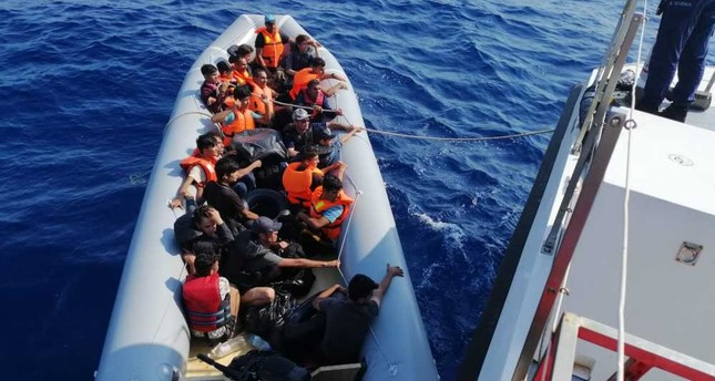 Illegal migrants stopped en route to Greece being taken to a Coast Guard boat off the coast of Bodrum in southwestern Turkey, Aug. 28, 2019.