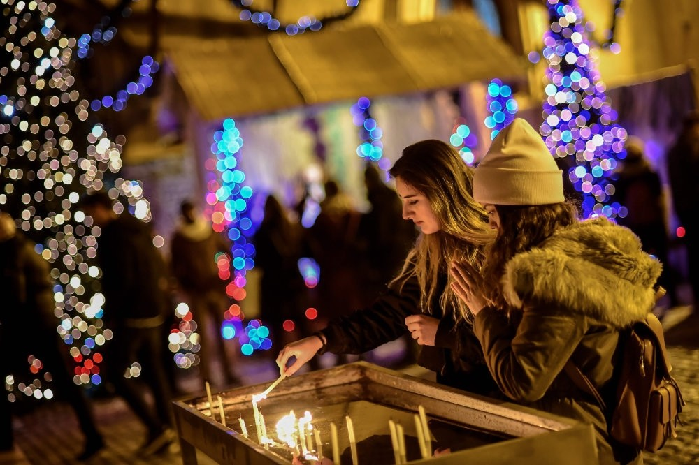 Worshippers light candles as they attend Christmas mass at Saint Antuan Church in the Beyou011flu district of Istanbul.