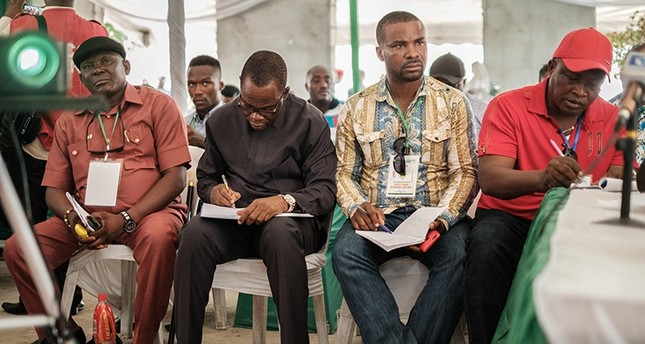 Representatives from parties listen as a collation officer reports the aggregattion total of votes at Rivers State collation centre in Port Harcourt, Southern Nigeria, on Feb. 25, 2019. (AFP Photo)