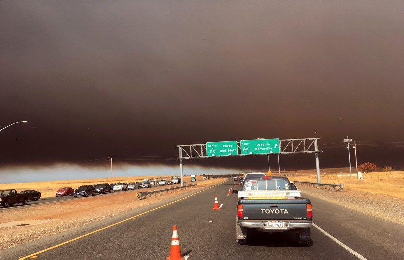 Smoke from the Camp Fire, burning in the Feather River Canyon near Paradise, Calif., darkens the sky as seen from Highway 99 near Marysville, Calif., Thursday, Nov. 8, 2018. (AP Photo)