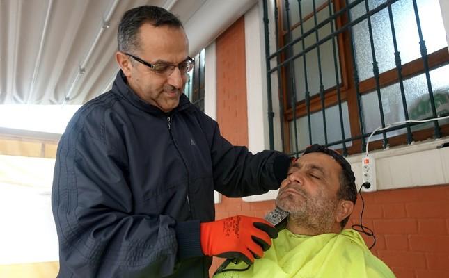 Imam  Osman Görkem shaves the beard of a homeless man in Selimiye Hatun Mosque in Beyoğlu, Istanbul.
