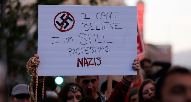 A demonstrator holds a sign during a rally, Oakland, California, Aug. 12, 2017. REUTERS Photo