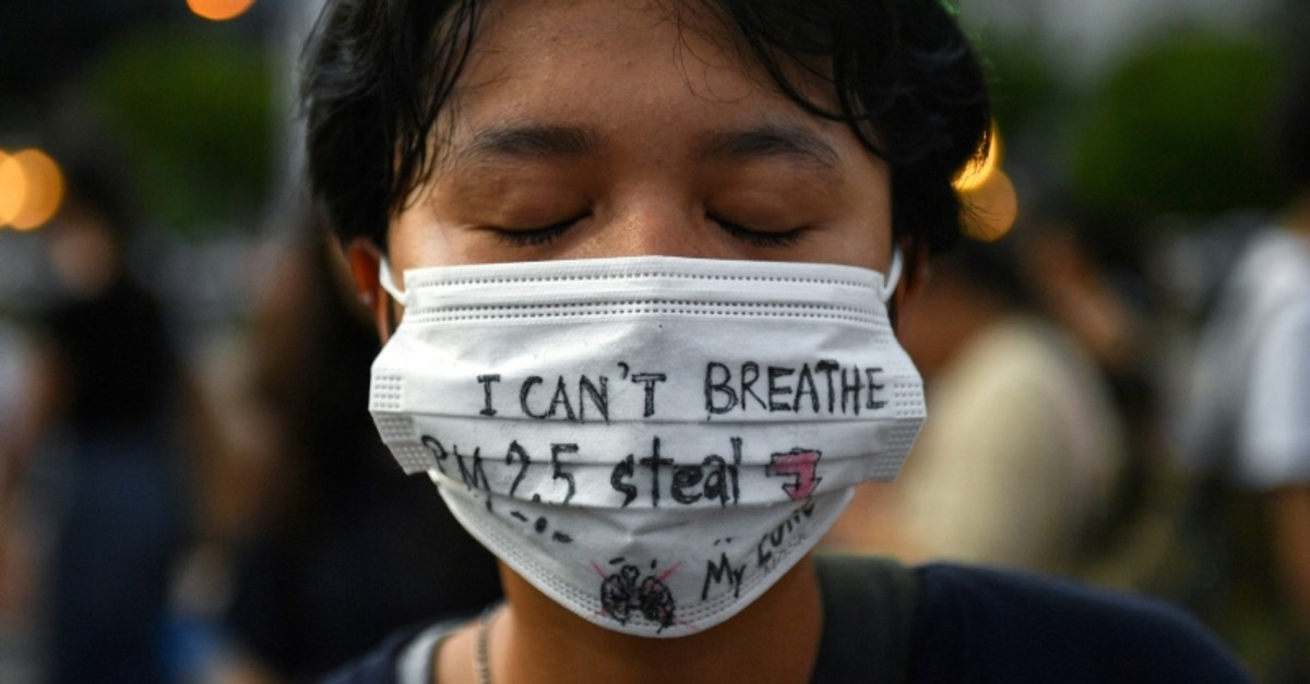 A climate change activists takes part in a protest against climate change consequences at Lumpini Park in Bangkok, Thailand November 29, 2019.(Reuters Photo)