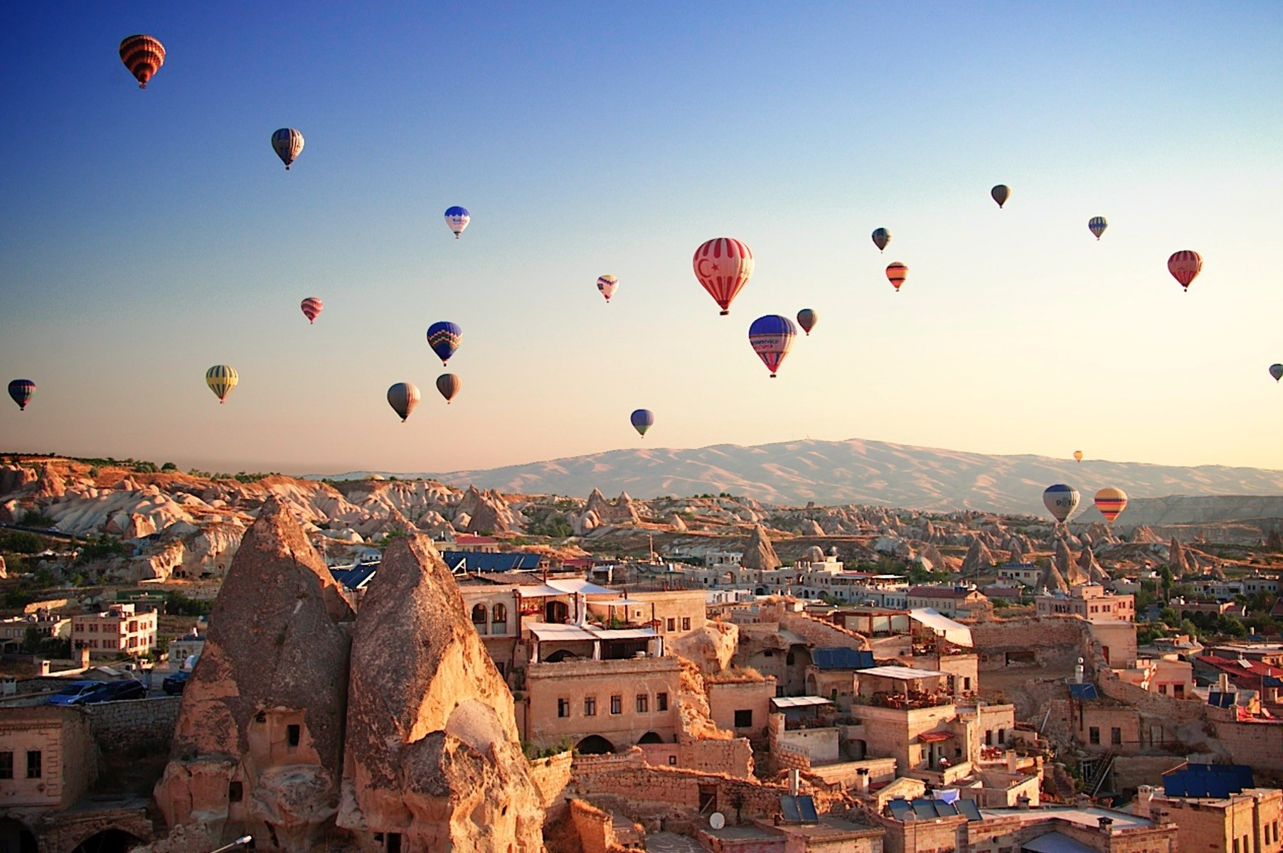Hot balloon tours are the signature of Cappadocia as visitors observe mesmerizing sunrises and sunsets over the landscape.