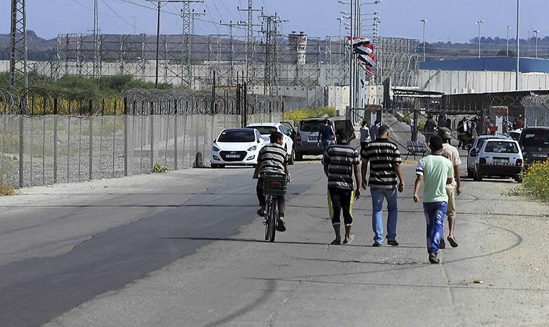 Residents walk toward the Palestinian side of the Erez checkpoint between Israel and Gaza, at Beit Hanoun, Gaza Strip, on Nov. 1, 2017. (AP Photo)