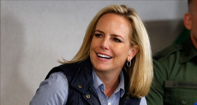 Homeland Security Secretary Kirstjen Nielsen listens to President Donald Trump at a roundtable on immigration and border security at the U.S. Border Patrol Calexico Station in Calexico, Calif., Friday April 5, 2019. (AP Photo)