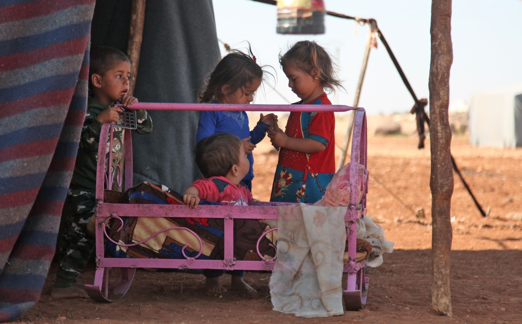 Syrian children play at a makeshift camp for displaced civilians fleeing from advancing Syrian regime forces, close to a Turkish military observation point near the village of Surman in the opposition-held northwestern Idlib province, Syria, Sept.5.