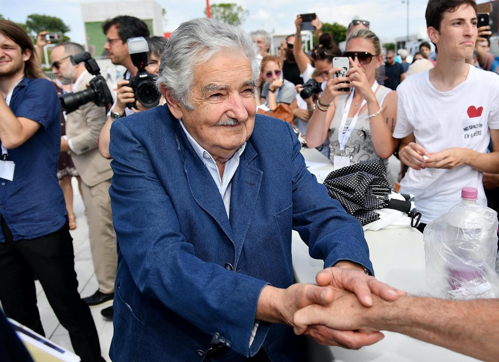 Former Uruguayan President Jose Mujica signs autographs and shakes hands of fans as he arrives for the premiere of u2018El Pepe, Una Vida Suprema.u201d