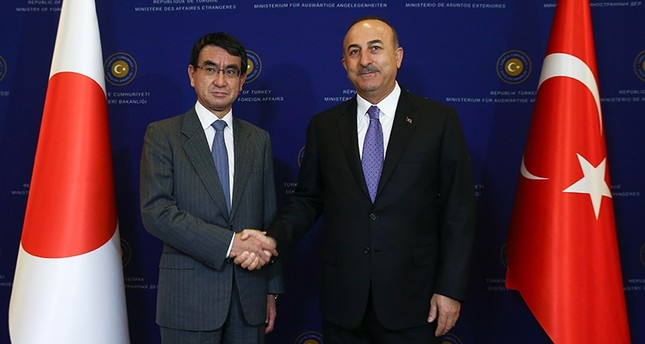 Foreign Minister Mevlüt Çavuşoğlu, right, and his Japanese counterpart Taro Kono shake hands after joint news conference in Ankara, Turkey, Dec. 28, 2017. (AA Photo)