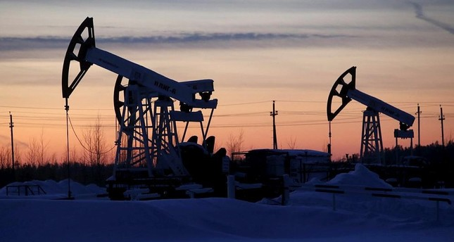 Oil prices rise to near five-week high, lift S&P, Dow to record levels