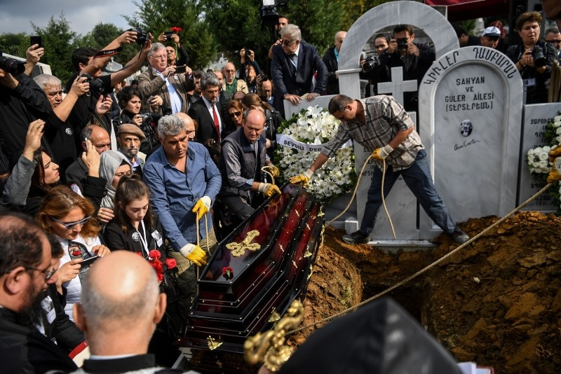 Güler's coffin is about to be deposited in the grave at the Şişli Armenian cemetery in Istanbul on October 20, 2018.