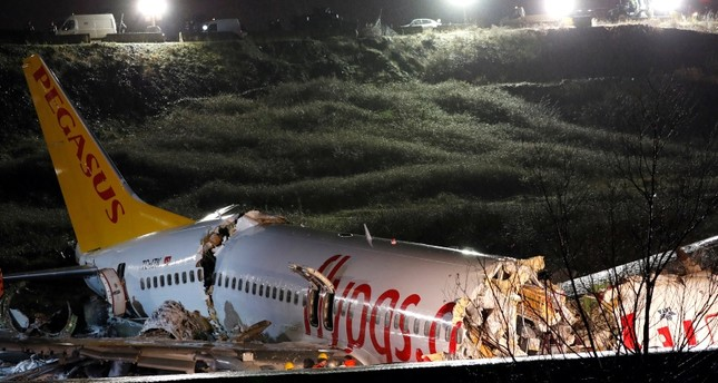 A view of the Pegasus Airlines Boeing 737-86J plane, that overran the runway during landing and crashed, at Istanbul's Sabiha Gokcen airport, Turkey February 5, 2020. Reuters Photo