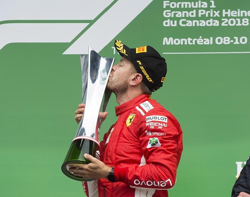 Ferrari driver Sebastian Vettel of Germany celebrates after winning the Canadian Grand Prix Sunday, June 10, 2018 in Montreal. (AP Photo)