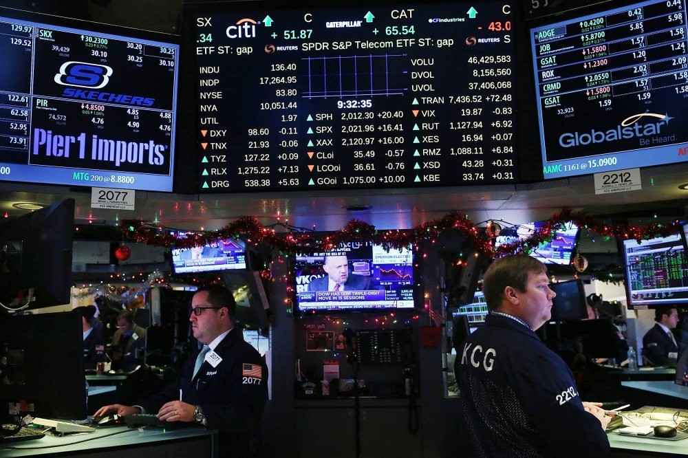 Traders work on the floor of the New York Stock Exchange in New York City, March 25, 2015.