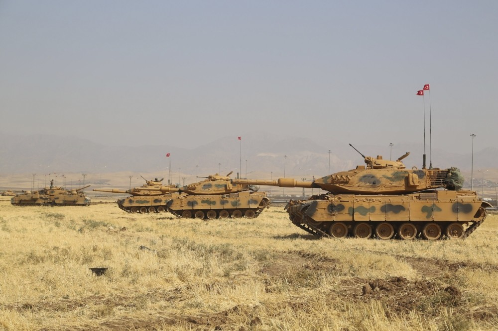 Turkish tanks are seen near the Habur crossing gate between Turkey and Iraq during a military drill on Sept. 18.