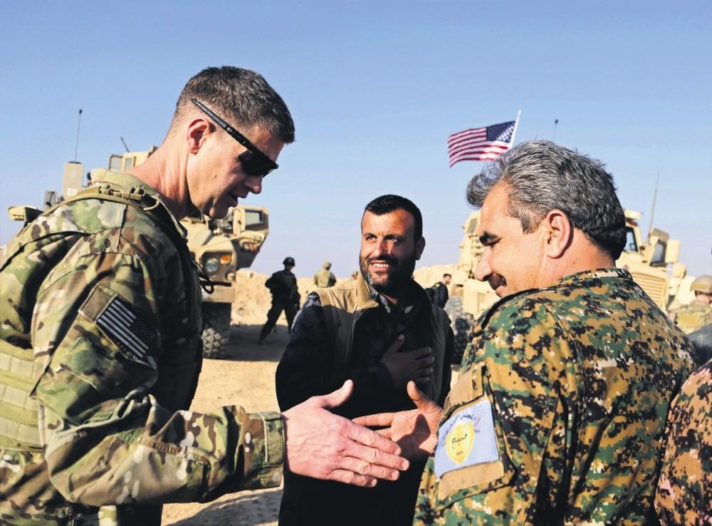 U.S. General Jamie Jarrard (L) thanks a YPG commander near the town of Manbij, northern Syria, Feb. 7, 2018.