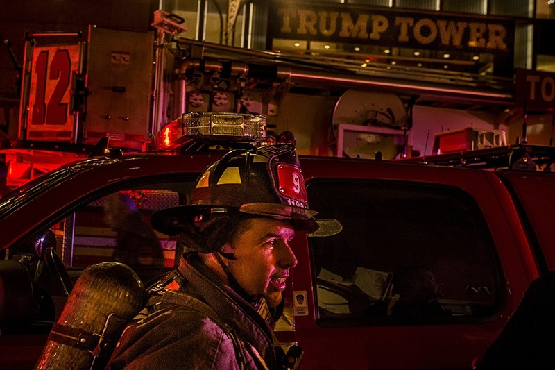 A firefighter works in front of Trump Tower after a fire in New York (AP Photo)
