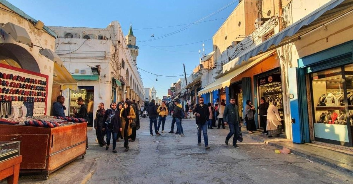 Libyans take a stroll on a shopping street in the old quarter of the capital Tripoli, Jan. 20, 2020. (AFP PHOTO)