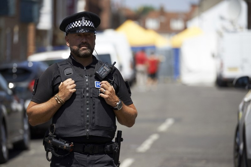 Police officers stands guard at a cordon near Rollestone Street, outside the John Baker House Sanctuary Supported Living in Salisbury, southern England, on July 7, 2018. (AFP Photo)