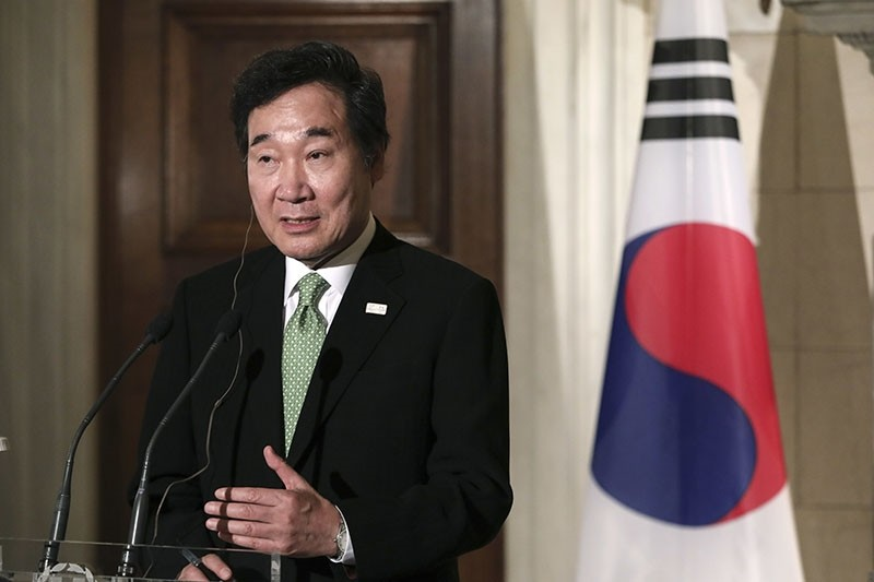 South Korea's Prime Minister Lee Nak-yon addresses reporters during a news briefing in Athens (AP Photo)