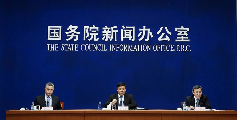 Chinese Vice Finance Minister Zhu Guangyao (C) and Chinese Vice Commerce Minister and Deputy China International Trade Representative Wang Shouwen (R) attend a news conference in Beijing, China (Reuters Photo)