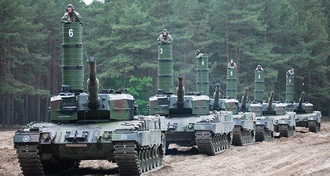 Soldiers of the 11th 'Lubuska' Armoured Cavalry Division of the Polish Land Forces drive their 'Leopard' tanks equipped with so-called 'Snorkels' in Biala Gora, west Poland, 06 June 2017. (EPA Photo)