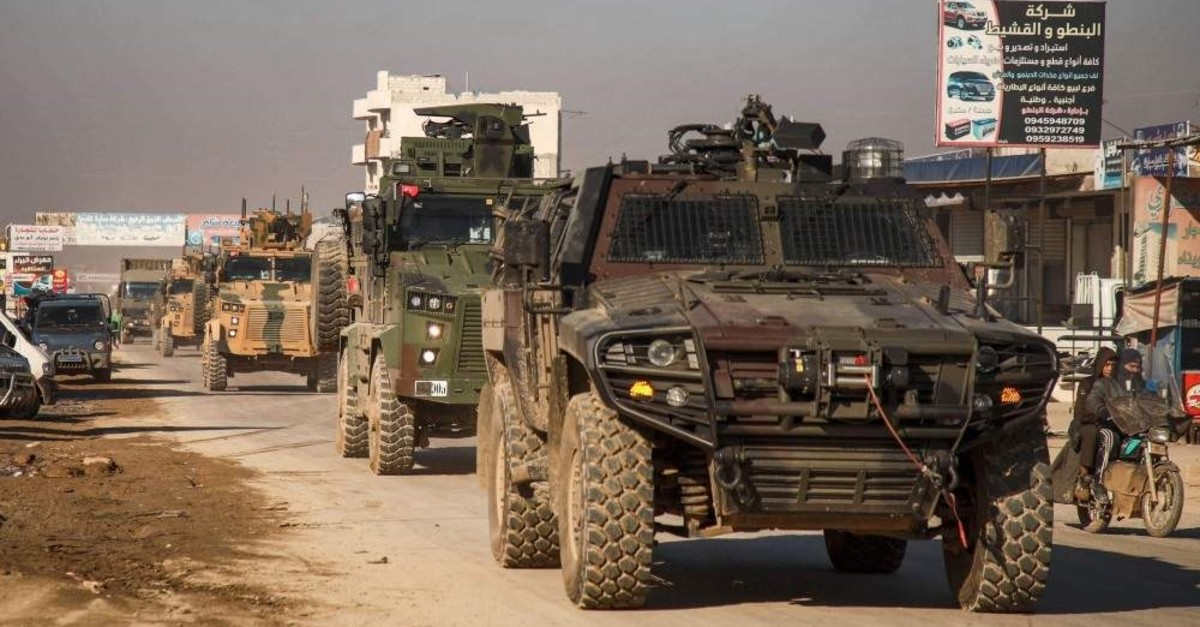 A Turkish military convoy of tanks and armoured vehicles passes through the Syrian town of Dana, east of the Turkish-Syrian border in the northwestern Syrian Idlib province, on February 2, 2020. (AFP Photo)