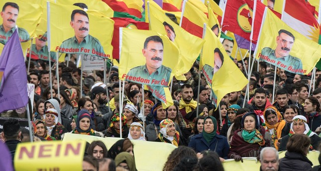PKK and YPG supporters in Germany gather and wave flags with portraits of imprisoned PKK Leader Abdullah Öcalan,  Frankfurt, March 18, 2017.