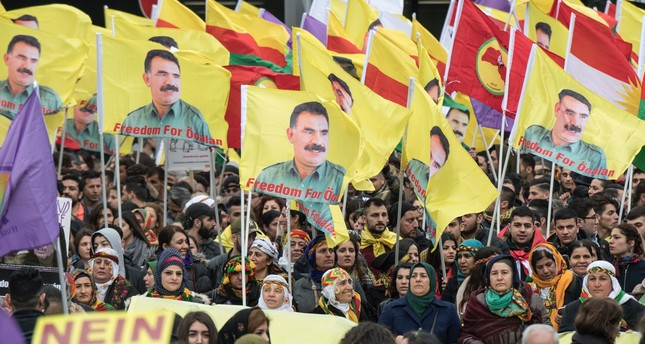 PKK terrorist group supporters seen in Frankfurt, Germany waving flags with portraits of the imprisoned PKK leader Abdullah Öcalan, who is responsible for killing hundreds of Kurdish and Turkish civilians and security forces, March 18.