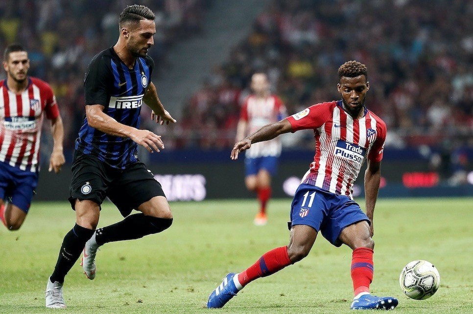 Atletico Madrid made the biggest signing of the Spanish summer by spending $84 million on Monacou2019s France winger Thomas Lemar (R)