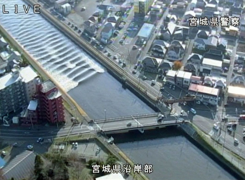 A tidal surge is seen in Sunaoshi River after tsunami advisories were issued following an earthquake in Tagajo, Miyagi prefecture, Japan November 22, 2016, in this video grab image. (Miyagi Prefectural Police/Kyodo/via Reuters)