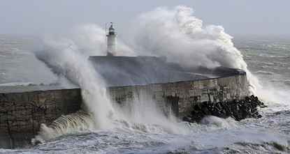 pPowerful winds battered parts of northwestern Europe Thursday, disrupting transportation, causing large scale blackouts and killing a woman who was hit by flying debris in central...