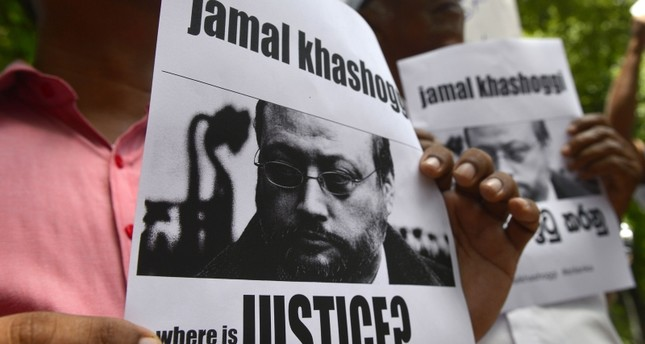 Members of the Sri Lankan web journalist association hold placards with the image of Saudi journalist Jamal Khashoggi during a demonstration outside the Saudi Embassy in Colombo on October 25, 2018. (AFP Photo)