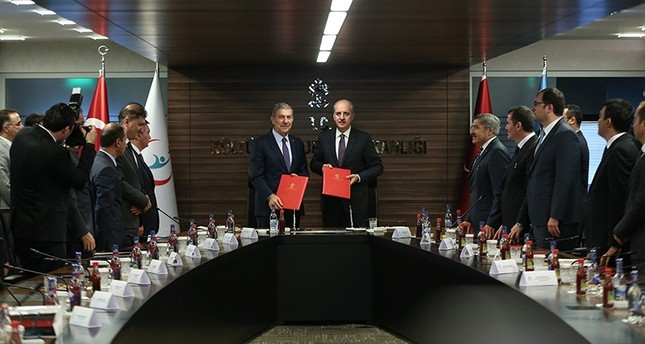 Minister of Health Ahmet Demircan (L) and Minister of Culture and Tourism Numan Kurtulmuş pose after signing the Protocol on Cooperation, Ankara, Turkey, Oct. 18, 2017. (AA Photo)