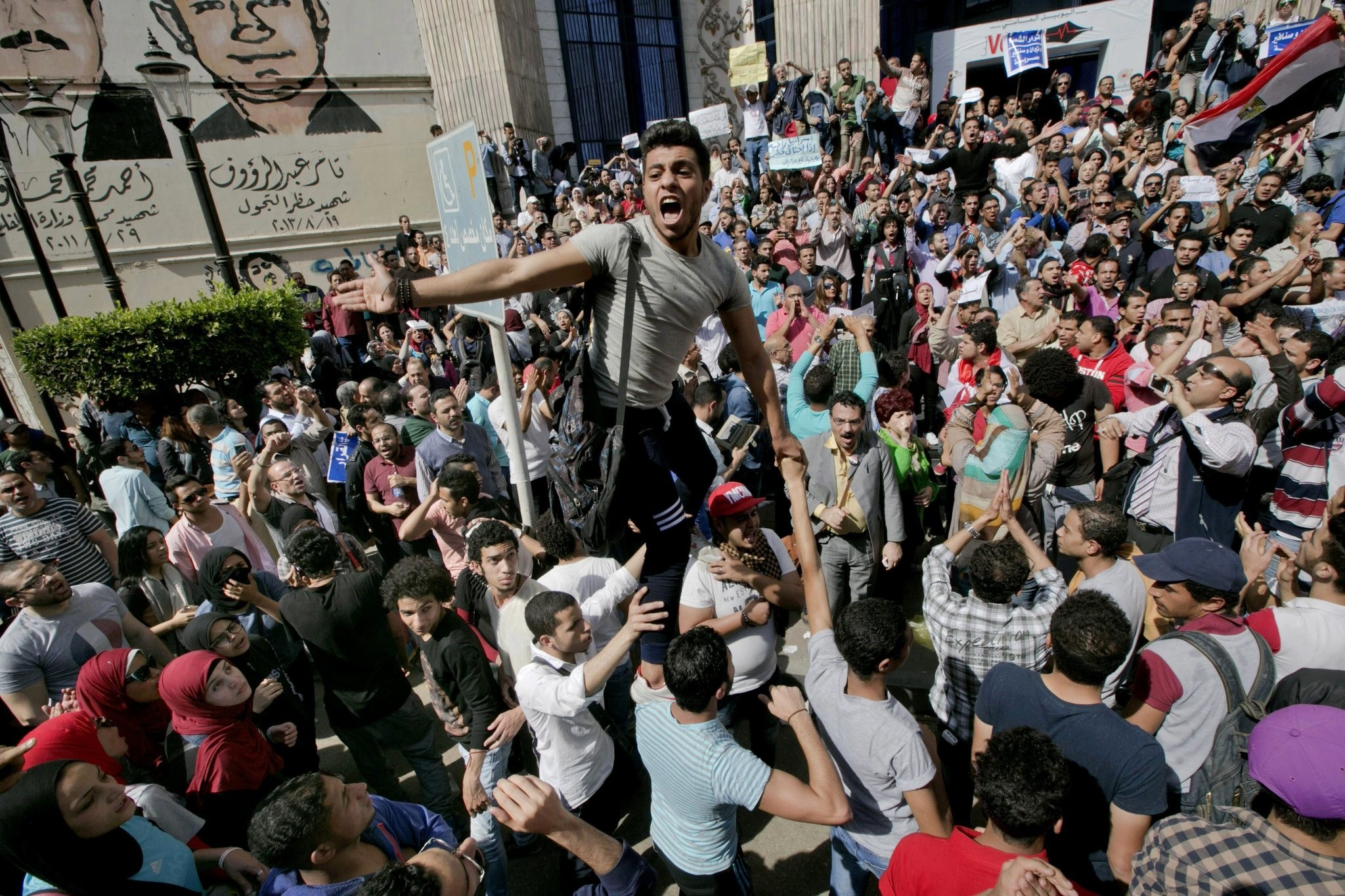 Egyptians shout slogans against President el-Sissi during a protest against the decision to hand over control of two strategic Red Sea islands to Saudi Arabia in front of the Press Syndicate, in Cairo, Egypt. (AP Photo)