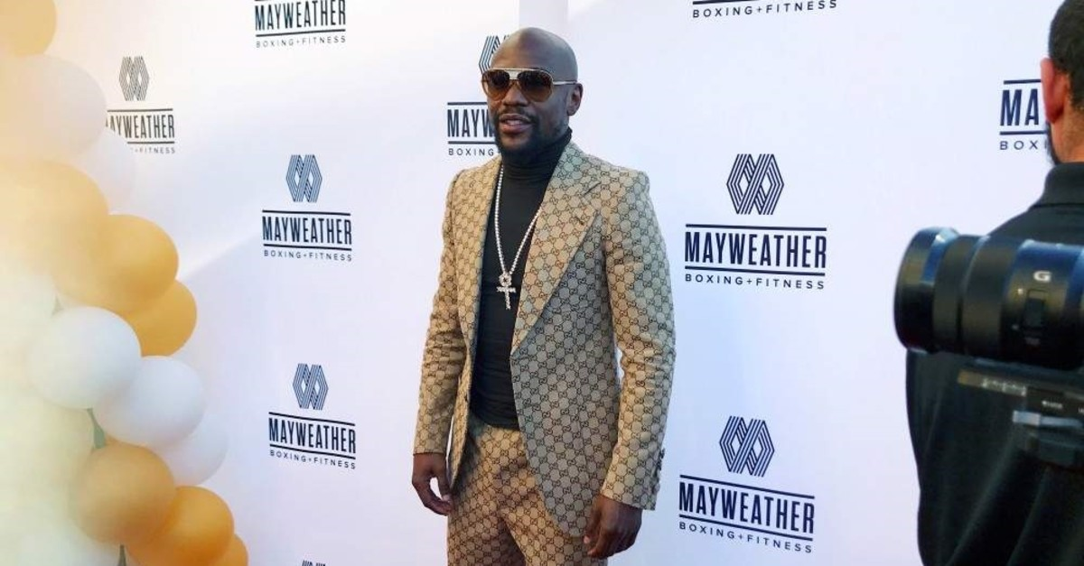 Mayweather poses at the opening in Torrance, Nov. 16, 2019. (Reuters)