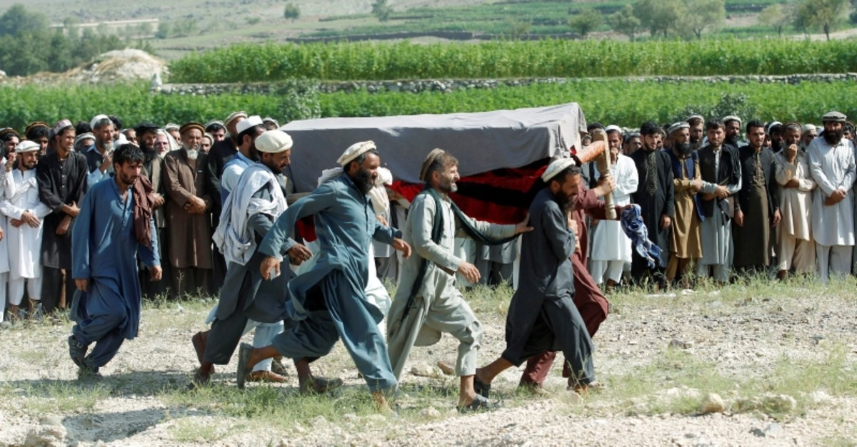 Men carry a coffin of one of the victims after a drone strike, in Khogyani district of Nangarhar province, Afghanistan Sept. 19, 2019. (Reuters Photo)
