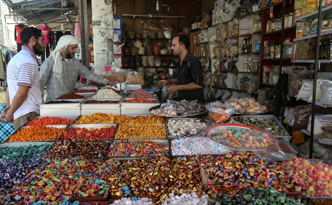 People buying sweets for bayram at a local market in Douma, Syria (AA Photo)