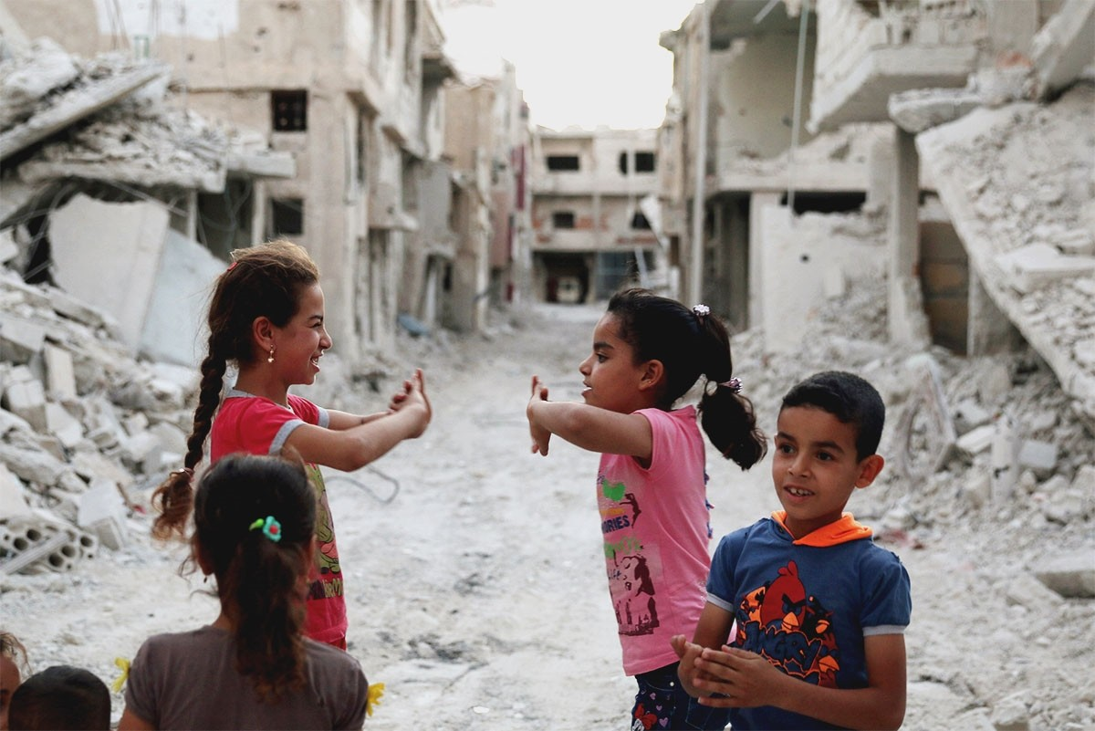 Syrian children play amid the rubble of damaged buildings in Deraa, July 15. The civil war has claimed more than 500,000 lives since March 2011. (Reuters Photo)