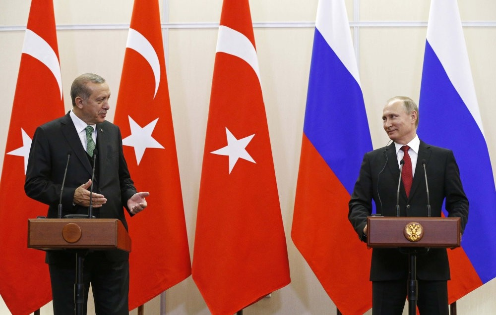 President Recep Tayyip Erdou011fan (L) with his Russian counterpart Vladimir Putin at a news conference in Sochi, May 3, 2017.