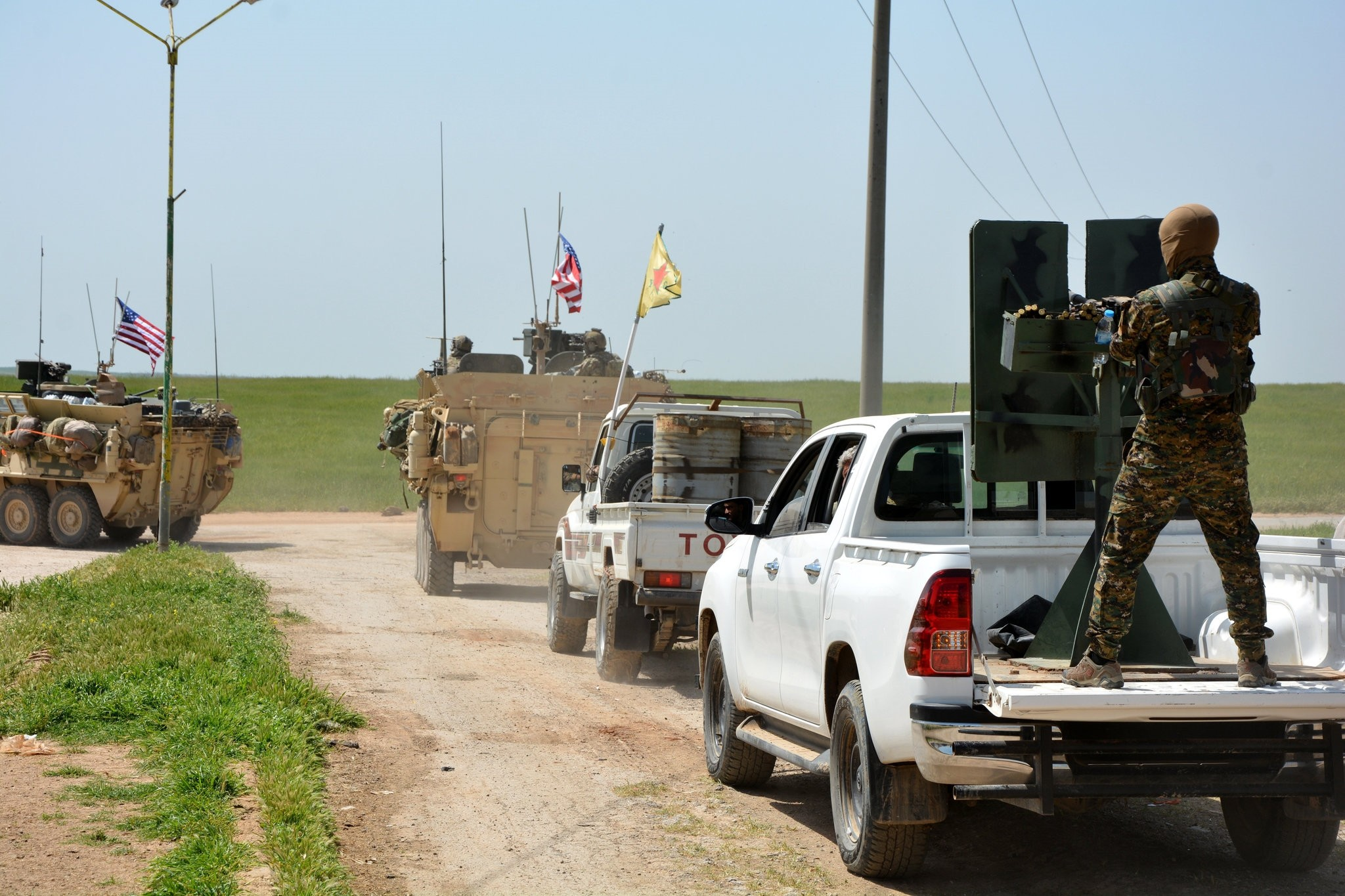 A convoy of U.S. army troops and the Kurdish terrorist group of the People's Protection Units (YPG), a PKK extension, patroling near the Syrian town of al-Darbasiyah at the Syrian-Turkish border, April 29. (FILE Photo)